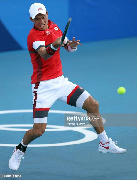 Kei Nishikori of Team Japan plays a forehand during his Men's Singles First Round match against Andrey Rublev of Team ROC on day two of the Tokyo...