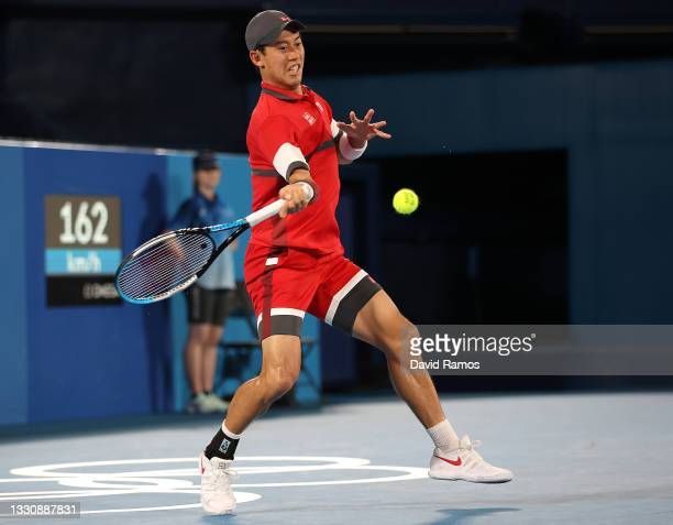 Kei Nishikori of Team Japan plays a forehand during his Men's Singles Second Round match against Marcos Giron of Team USA on day four of the Tokyo...