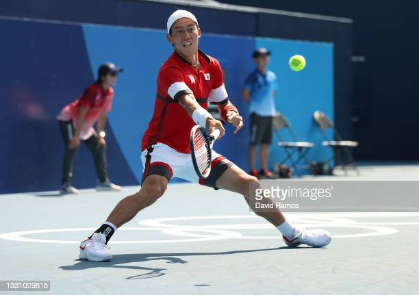 Kei Nishikori of Team Japan plays a forehand during his Men's Singles Third Round match against Ilya Ivashka of Team Belarus on day five of the Tokyo...