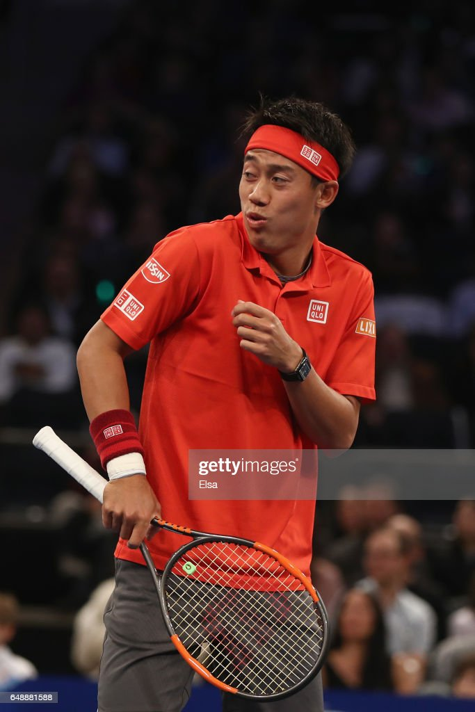 Kei Nishikori, paired with Garbine Muguruza (not pictured), of Team World reacts while playing against Venus Williams and Juan Martin del Potro (not pictured) in their Mixed Doubles match during the BNP Paribas Showdown at Madison Square Garden on March 6, 2017 in New York City.
