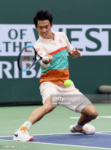 Kei Nishikori returns the ball during the third set of a match played at the BNP Paribas Open on March 10, 2019 at the Indian Wells Tennis Garden in...