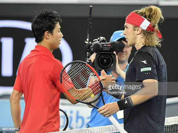 Kei Nishikori shakes hands with Lukas Lacko after defeating the Slovak opponent 64 64 64 in the third round of the Australian Open in Melbourne on...