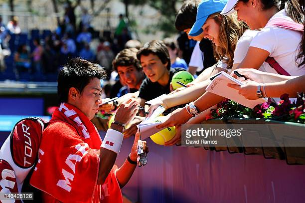 Kei Nishikori signs autographs after winning his match against Albert Ramos on day 4 of the ATP 500 World Tour Barcelona Open Banco Sabadell 2012...