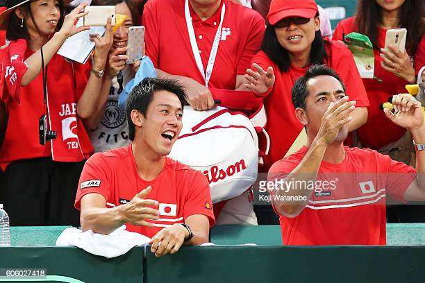 Kei Nishikoriof Japan celebrates the winner Illya Marchenko of Ukraine during the Davis Cup World Group Playoff singles match betweenat Utsubo Tennis...