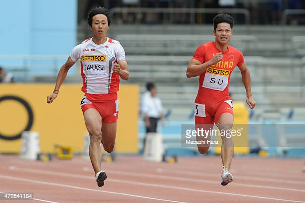 Kei Takase and Su Bingtian compete in M100m during the Seiko Golden Grand Prix Tokyo 2015 at Todoroki Stadium on May 10 2015 in Kawasaki Japan