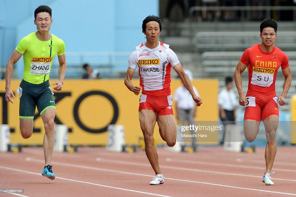 Kei Takase (2L), Peimeng Zhang (L) and Bingtian Su compete in the M100m during the Seiko Golden Grand Prix Tokyo 2015 at Todoroki Stadium on May 10, 2015 in Kawasaki, Japan.