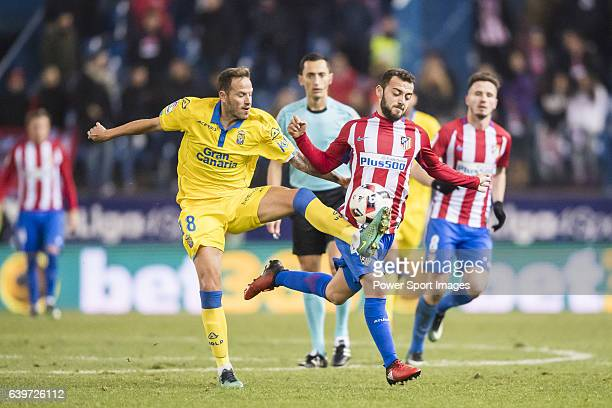 Keidi Bare of Atletico de Madrid battles for the ball with Javi Castellano of UD Las Palmas during their Copa del Rey 201617 Round of 16 match...