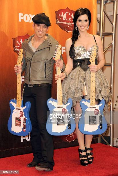 Keifer Thompson and Shawna Thompson of Thompson Square pose in the press room with the awards for Single of the Year Group Single of the Year New...