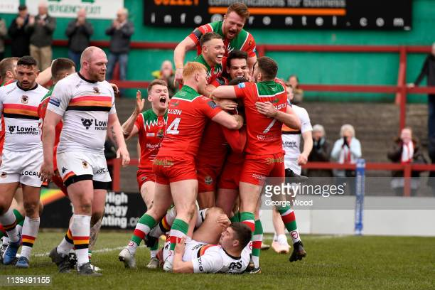 Keighley Cougars players celebrate the opening try scored by Buster Feather during the Challenge Cup match between Keighley Cougars and Bradford...