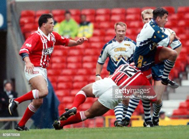 Divisional Premiership Final Salfords Lukeni Savelio clings on to Keighleys Daryl Powell in the game at Old Trafford today Photo by Dave Kendall/PA