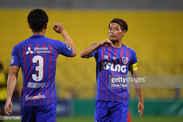 Keigo Higashi and Masato Morishige of FC Tokyo elbow bump during the J.League Meiji Yasuda J1 match between Kashiwa Reysol and FC Tokyo at Sankyo...
