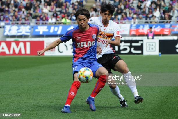 Keigo Higashi of FC Tokyo and Takuji Yonemoto of Nagoya Grampus compete for the ball during the J.League J1 match between FC Tokyo and Nagoya Grampus...
