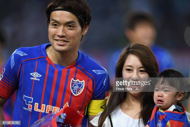 Keigo Higashi of FC Tokyo attends a ceremony marking his 200th appearance of the J.League J1 with his wife and daughter prior to the J.League J1...