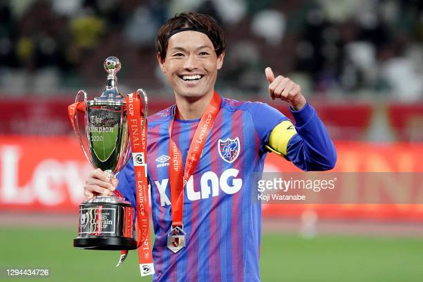 Keigo Higashi of FC Tokyo lifts the trophy as they celebrate during the J.League YBC Levain Cup final between Kashiwa Reysol and FC Tokyo at the...