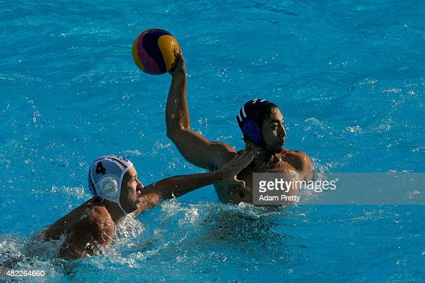 Keigo Okawa of Japan is closed down by Sava Randelovic of Serbia in the Men's Water Polo Preliminary Round Group D match between Serbia and Japan on...