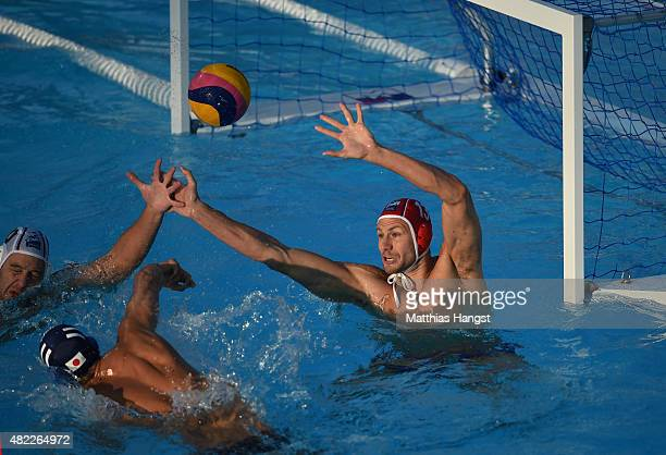 Keigo Okawa of Japan takes a shot against Branislav Mitrovic of Serbia in the Men's Water Polo Preliminary Round Group D match between Serbia and...