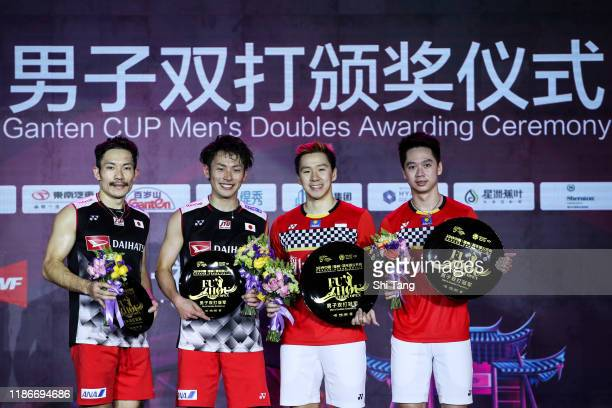 Keigo Sonoda and Takeshi Kamura of Japan and Marcus Fernaldi Gideon and Kevin Sanjaya Sukamuljo of Indonesia pose with their trophies after the Men's...