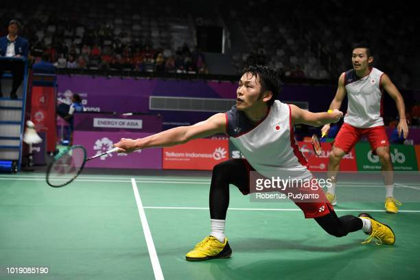 Keigo Sonoda and Takeshi Kamura of Japan compete against Goh Wei Shem and Tan Wee Kiong of Malaysia during Badminton Men's Team Round of 16 on day...