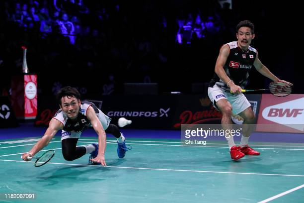 Keigo Sonoda and Takeshi Kamura of Japan compete in the Men's Doubles semi finals match against Hendra Setiawan and Mohammad Ahsan of Indonesia on...