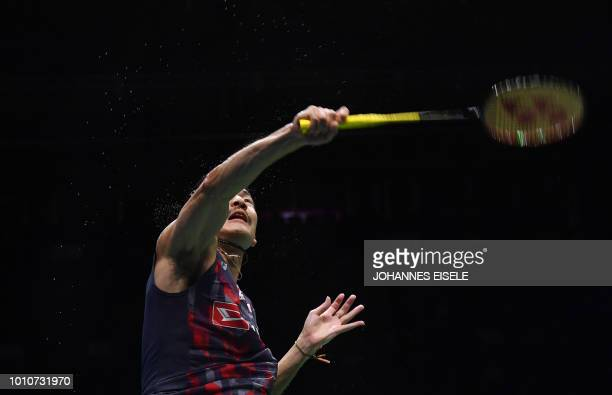 Keigo Sonoda of Japan and Takeshi Kamura hit a shot against Chen Hung Ling and Wang ChiLin of Taiwan in their men's doubles semifinal match during...
