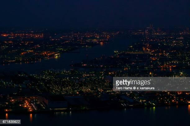 Keihin factory area in Kawasaki and Yokohama city night aerial view from airplane