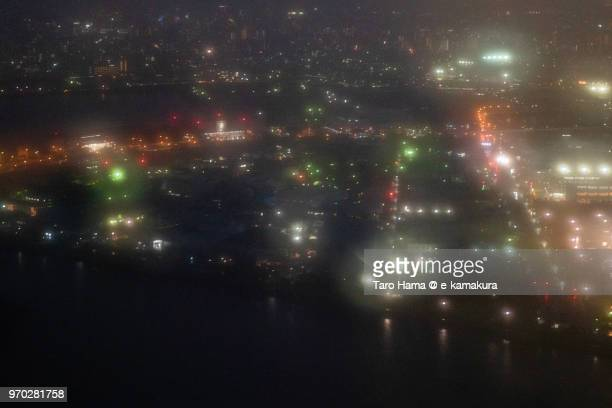 Keihin Island in Tokyo Bay night time aerial view from airplane