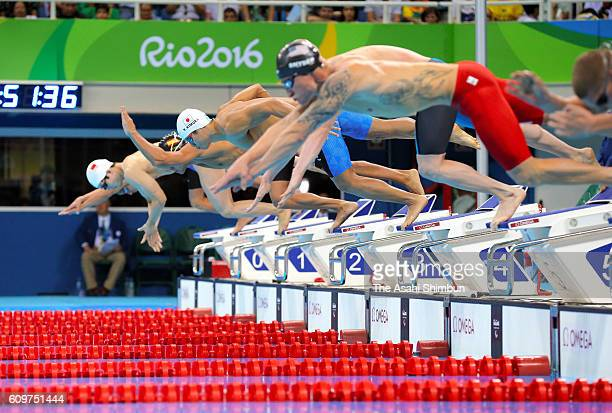 Keiichi Kimura of Japan dives to compete in the Men's 100m Butterfly S11 Final on day 7 of the 2016 Rio Paralympic Games at the Olympic Aquatics...