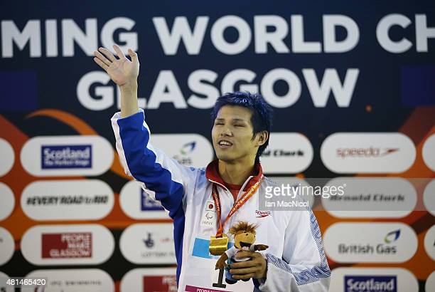Keiichi Kimura of Japan poses with his gold medal from the final of the Men's 100m Butterfly S11 during Day Seven of The IPC Swimming World...