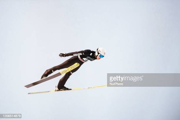 Keiichi Sato soars in the air during the men's large hill team competition HS130 of the FIS Ski Jumping World Cup in Lahti, Finland, on February 29,...
