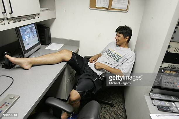 Keiichi Yabu of the Oakland Athletics looks at video before the game against the Seattle Mariners at McAfee Coliseum on June 30 2005 in Oakland...