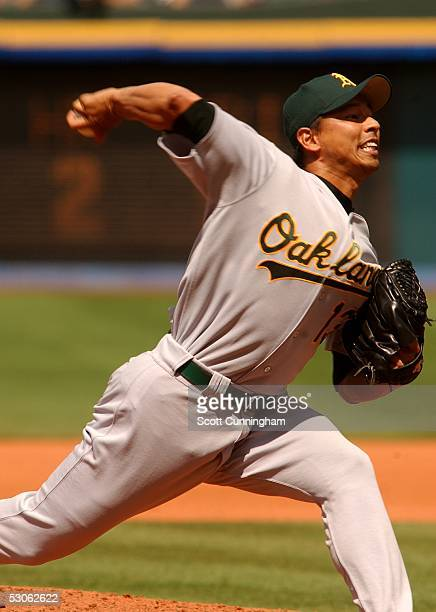 Keiichi Yabu of the Oakland Athletics pitches against the Atlanta Braves at Turner Field on June 12 2005 in Atlanta Georgia The Athletics won the...