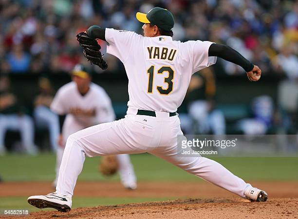 Keiichi Yabu of the Oakland Athletics pitches against the New York Yankees during a MLB game at McAfee Coliseum on September 4 2005 in Oakland...
