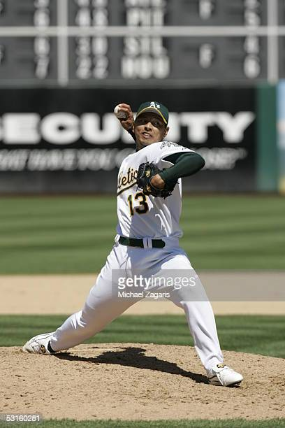 Keiichi Yabu of the Oakland Athletics pitches during the game against the Toronto Blue Jays at McAfee Coliseum on June 5 2005 in Oakland California...