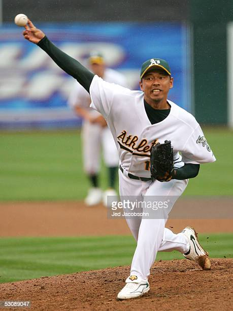 Keiichi Yabu of the Oakland Athletics pitches in the ninth inning against the New York Mets at McAfee Coliseum on June 16 2005 in Oakland California...