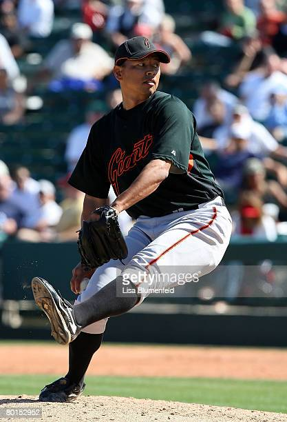 Keiichi Yabu of the San Francisco Giants pitches during a Spring Training game against the Los Angeles Angels of Anaheim at Tempe Diablo Stadium on...