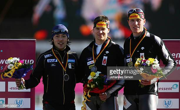 Keiichiro Nagashima of Japan Mike Ireland of Canada and Jeremy Wotherspoon of Canada celebrate after the 500m heats during Day 2 of the Essent ISU...