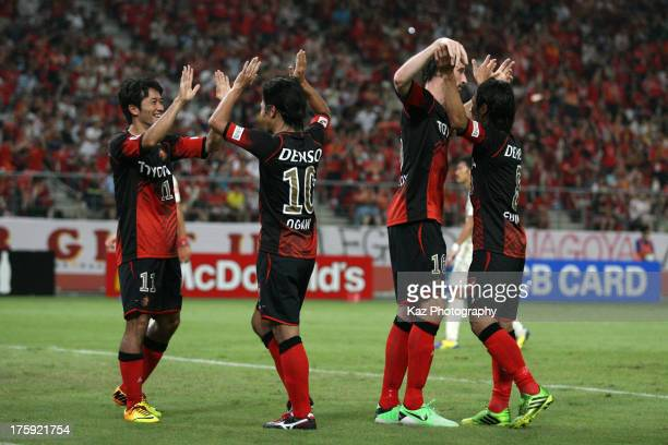 Keij Tamada of Nagoya Grampus celebrates scoring his team's first goal with his teammates Yoshizumi Ogawa , Joshua Kennedy and Jungo Fujimoto during...