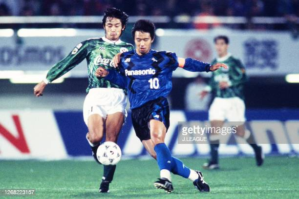 Keiji Ishizuka of Verdy Kawasaki and Hiromitsu Isogai of Gamba Osaka compete for the ball during the JLeague Nicos Series match between Gamba Osaka...