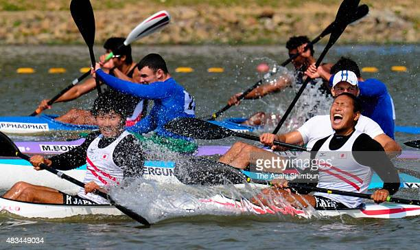 Keiji Mizumoto and Momotaro Matsushita of Japan react after winning the gold in the Canoe Sprint Men's Kayak Pair 200m during the day fourteen of the...