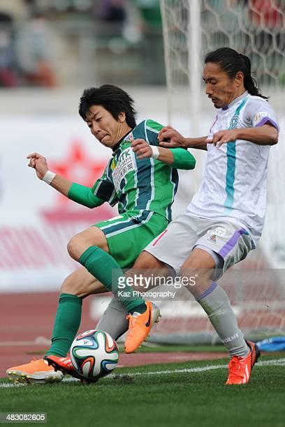Keiji Takachi of FC Gifu and Daisuke Sakata of Avispa Fukuoka compete for the ball during the J League second division match between FC Gifu and...