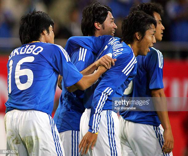 Keiji Tamada of Japan celebrates with his teammates after scoring their second goal during the Kirin Challenge Cup international friendly match...