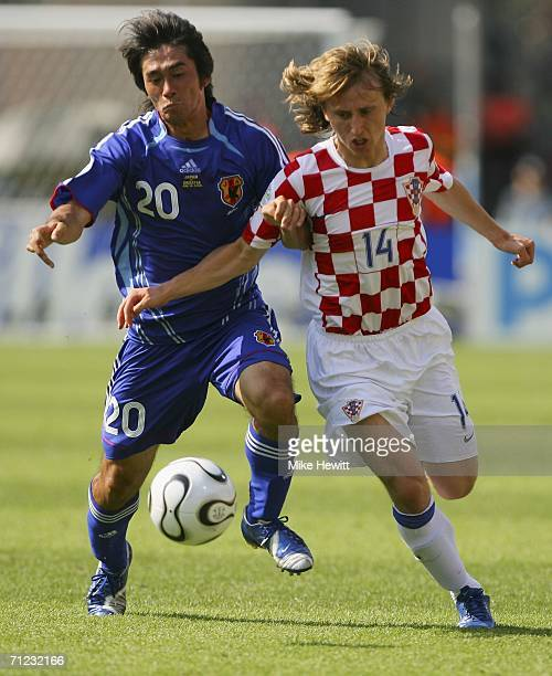 Keiji Tamada of Japan competes for the ball with Luka Modric of Croatia during the FIFA World Cup Germany 2006 Group F match between Japan and...