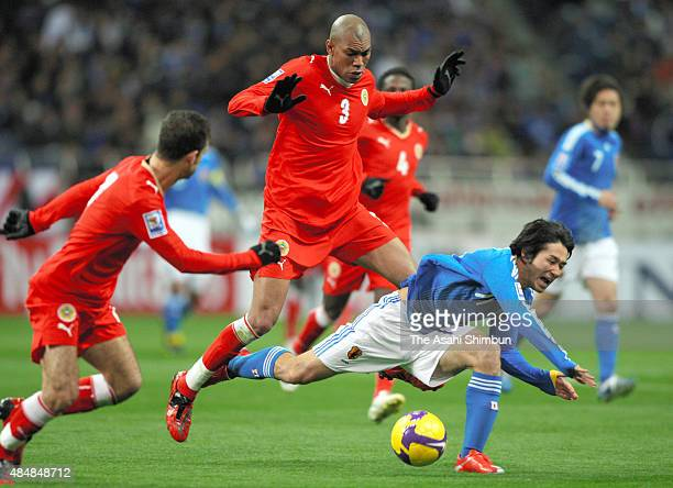 Keiji Tamada of Japan is brought down by Bahrain defense during the FIFA World Cup Qualifier match between Japan and Bahrain at Saitama Stadium on...