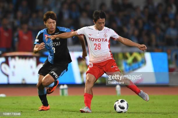 Keiji Tamada of Nagoya Grampus and Shintaro Kurumaya of Kawasaki Frontale compete for the ball during the J.League J1 match between Kawasaki Frontale...