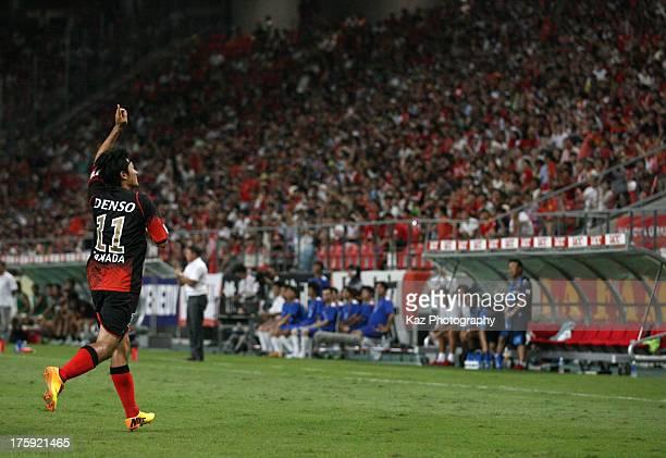 Keiji Tamada of Nagoya Grampus celebrate scoring his team's first goal during the J.League match between Nagoya Grampus and Urawa Red Diamonds at...