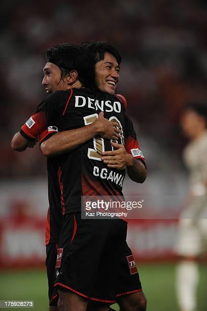 Keiji Tamada of Nagoya Grampus celebrates scoring his team's first goal with his team mate Yoshizumi Ogawa during the J.League match between Nagoya...