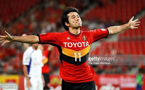 Keiji Tamada of Nagoya Grampus celebrates scoring his team's first goal during the JLeague match between Nagoya Grampus and Ventforet Kofu at Toyota...