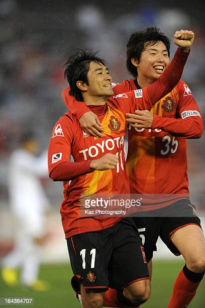 Keiji Tamada of Nagoya Grampus celebrates scoring the first goal with his teammate Teruki Tanaka during the JLeague Yamazaki Nabisco Cup match...