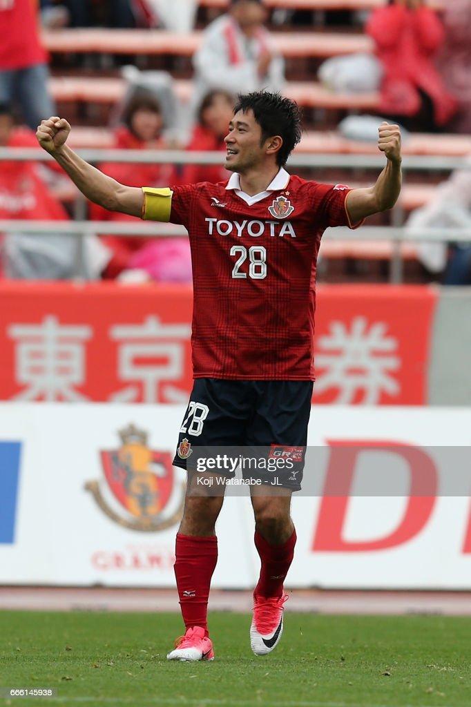 Keiji Tamada of Nagoya Grampus celebrates scoring the opening goal from a free kick during the J.League J2 match between Nagoya Grampus and Kamatamare Sanuki at Paroma Mizuho Stadium on April 8, 2017 in Nagoya, Aichi, Japan.