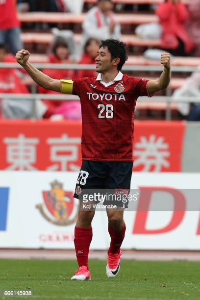 Keiji Tamada of Nagoya Grampus celebrates scoring the opening goal from a free kick during the J.League J2 match between Nagoya Grampus and...